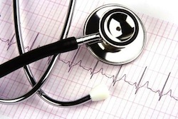 A stethoscope over a electrocardiogram close up.